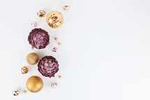 pink, purple, gold, and silver Christmas decorations on white