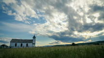 clouds in the sky over a rural country church