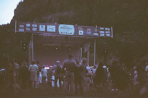 crowds around a stage at an outdoor music festival