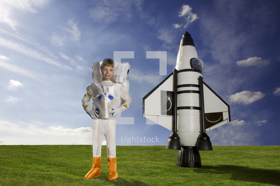 Young Astronaut standing in front of Rocket - for editorial use only
