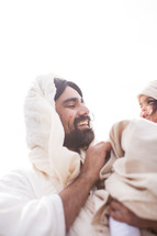 Jesus holding a child