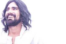A smiling Jesus with a white background.