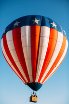 A hot air balloon in the colors of the United States flag.