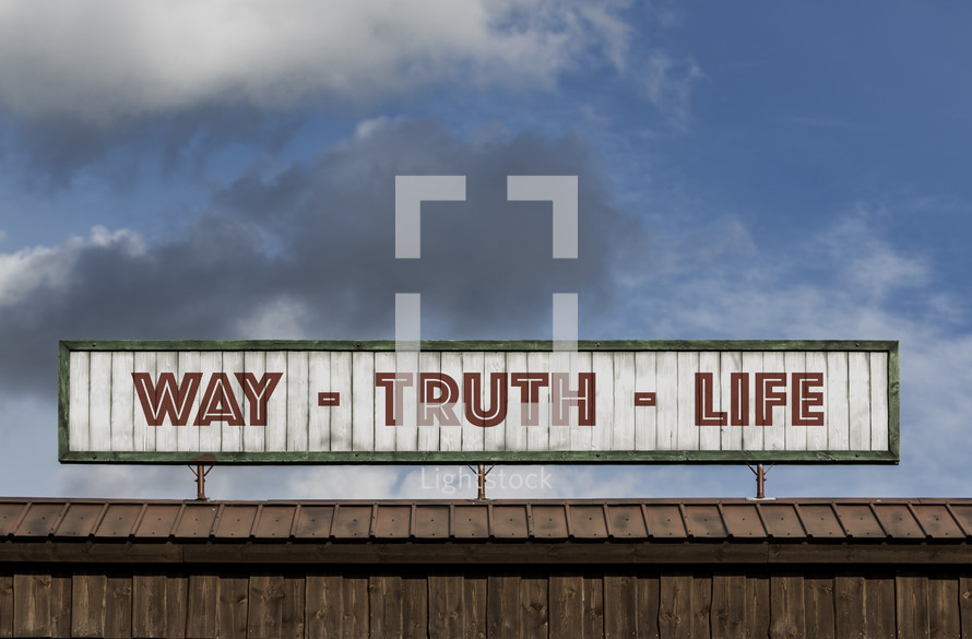 Way - Truth - Light sign on the roof of a building
