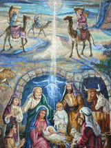 A large colorful mural painting depicting the birth of Jesus showing the wise men appearing on camel and Jesus in the manger surrounded by Mary and Joseph, shepherds and angels.