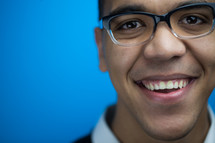 face of a smiling man in glasses