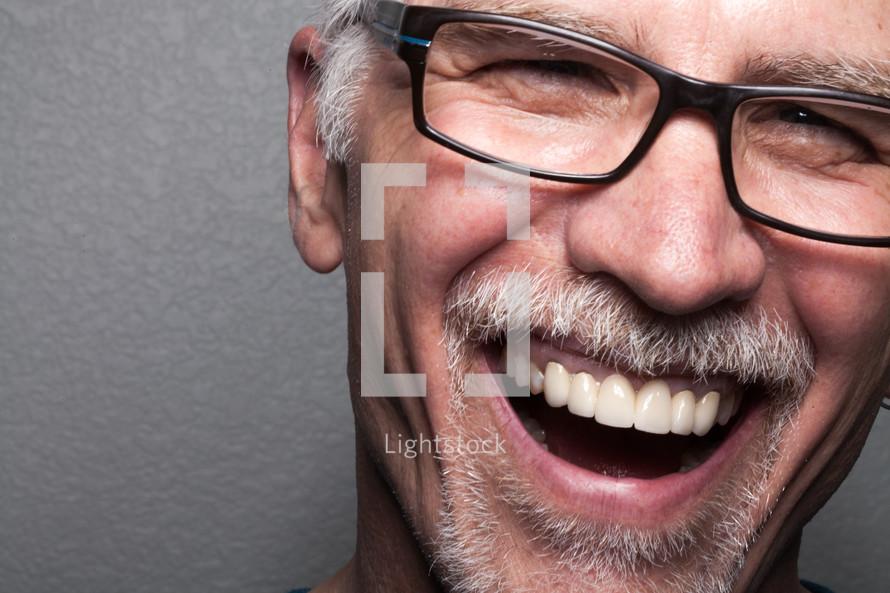 closeup of a smiling man's face