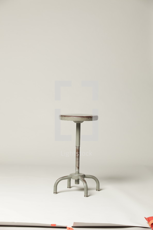 empty stool in a studio