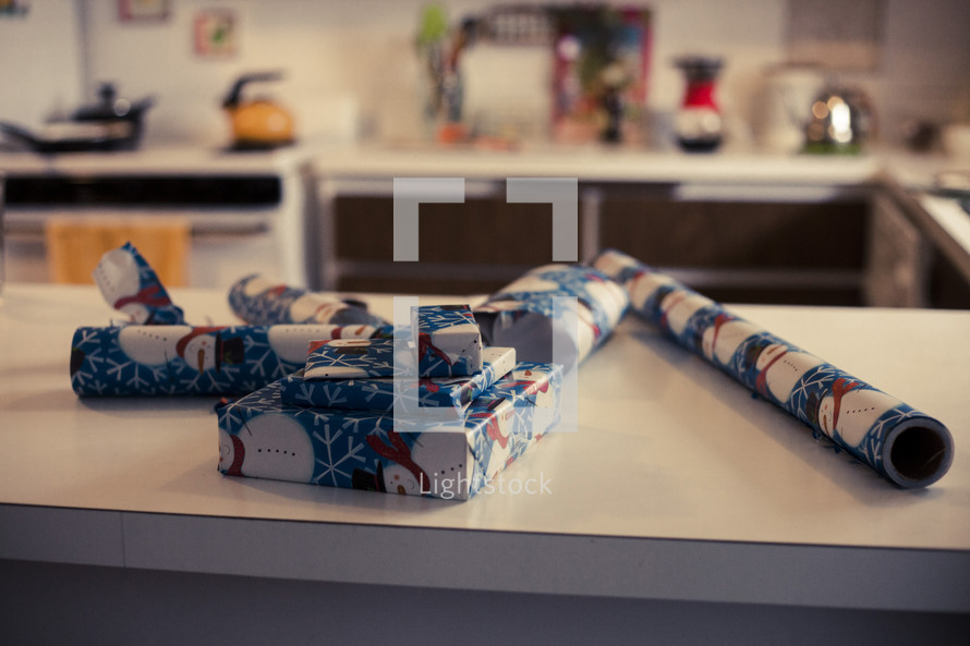 wrapped Christmas presents on a kitchen counter
