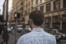 a man walking down a busy city sidewalk