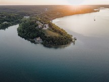 aerial view over a lake shore