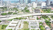 Aerial Drone View of Cityscape and Vehicles on Expressway