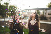 women throwing confetti