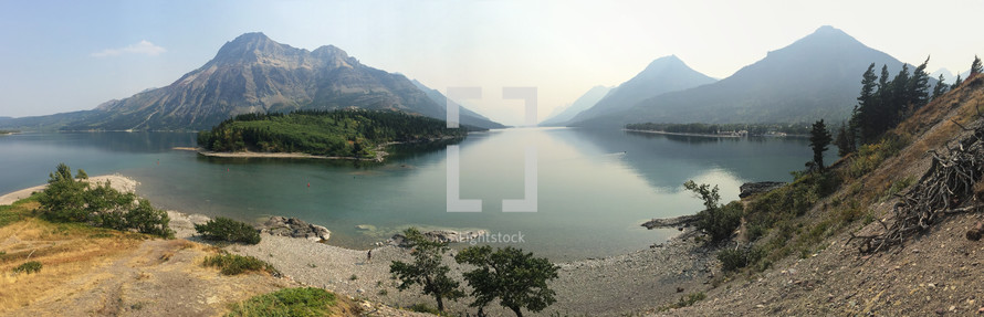 a panoramic shot of mountains and lake with iphone