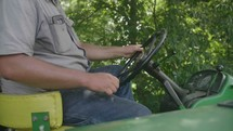 A man riding a tractor