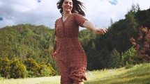 happy young woman spinning outdoors