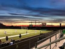girls soccer team on a soccer field at night