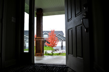 open front door and red fall tree