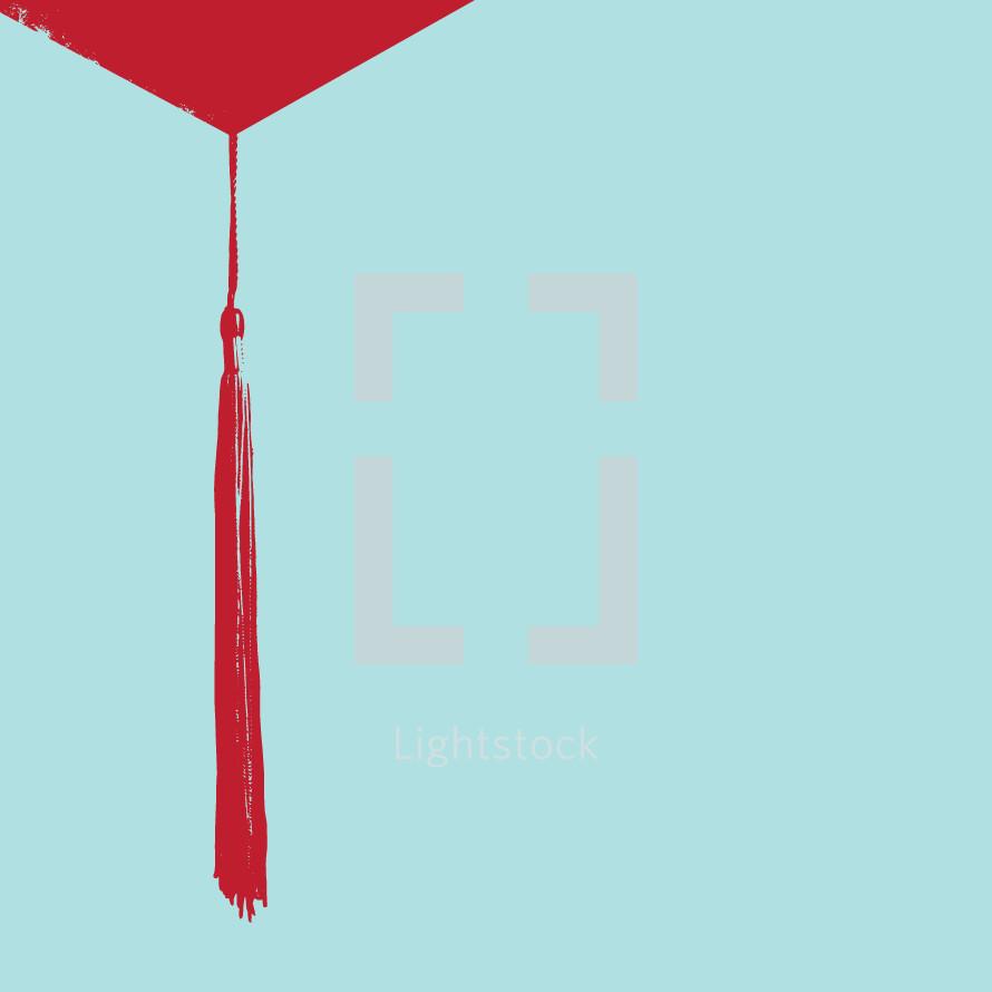 Graduation cap tassel.