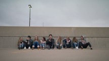 youth sitting and talking on the top of a parking garage