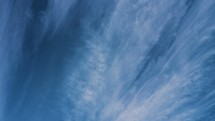 wispy clouds in a blue sky