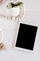 wooden beads and tablet