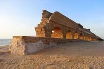 Ancient aqueduct at Caesarea by the Mediterranean Sea