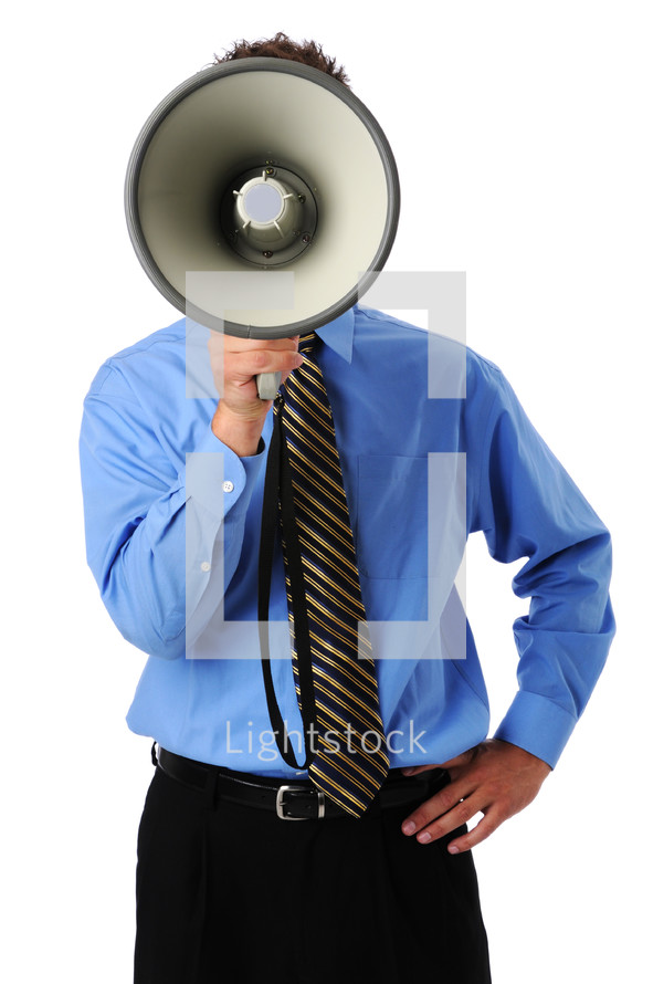 Man speaking in a bullhorn; bullhorn covers his face