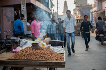 roasting peanuts on a street in India