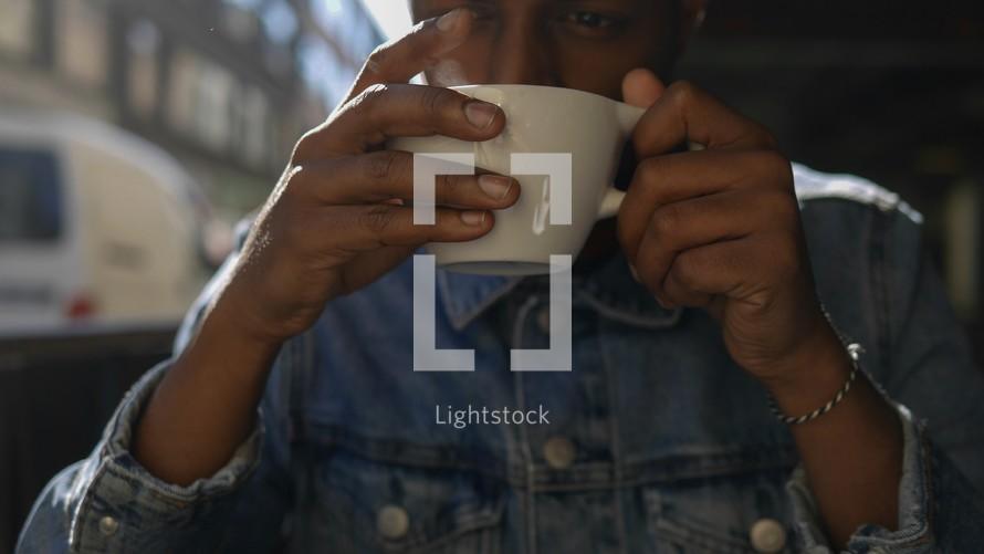man drinking coffee in Gothenburg, Sweden
