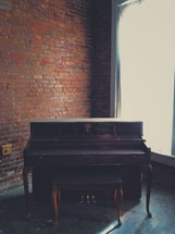 old piano in an empty room