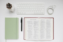 succulent plant, journal, mint green, pen, open Bible, pages, white background, earbuds, computer keyboard, desk, Bible study, modern