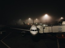 airplane on the tarmac at night