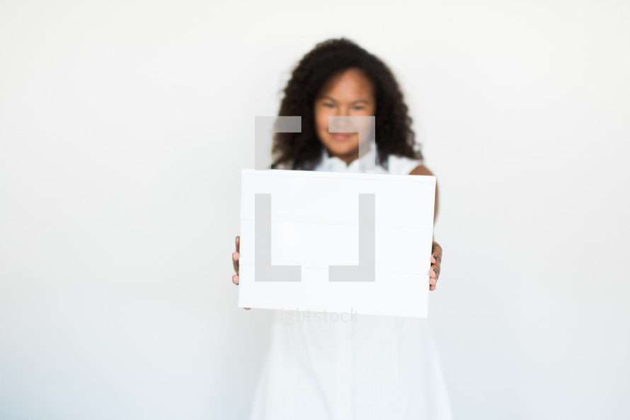 teen girl holding a blank sign