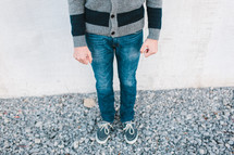legs of a boy wearing a sweater