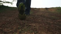 feet walking down a path slowly