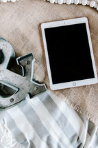iPad and & symbol on burlap