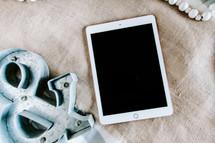 tablet, burlap cloth, and & symbol
