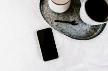 galvanized tray, coffee, sugar, spoon, and cellphone
