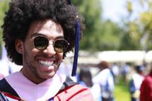 A smiling graduate