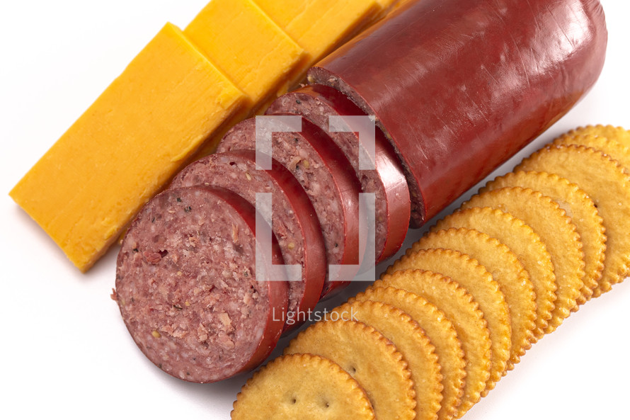 summer sausage, cheese, and cracker tray