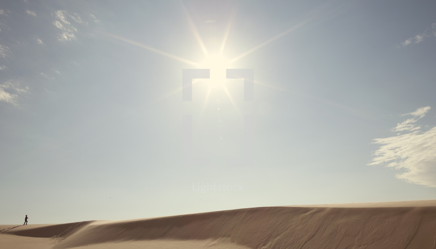 sunburst over a sand dune