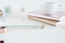 mint, winter, desk, home office, pencils, journals, white, white background, thoughts, notes, tape, rolls, tape dispenser, cup, mug, metallic