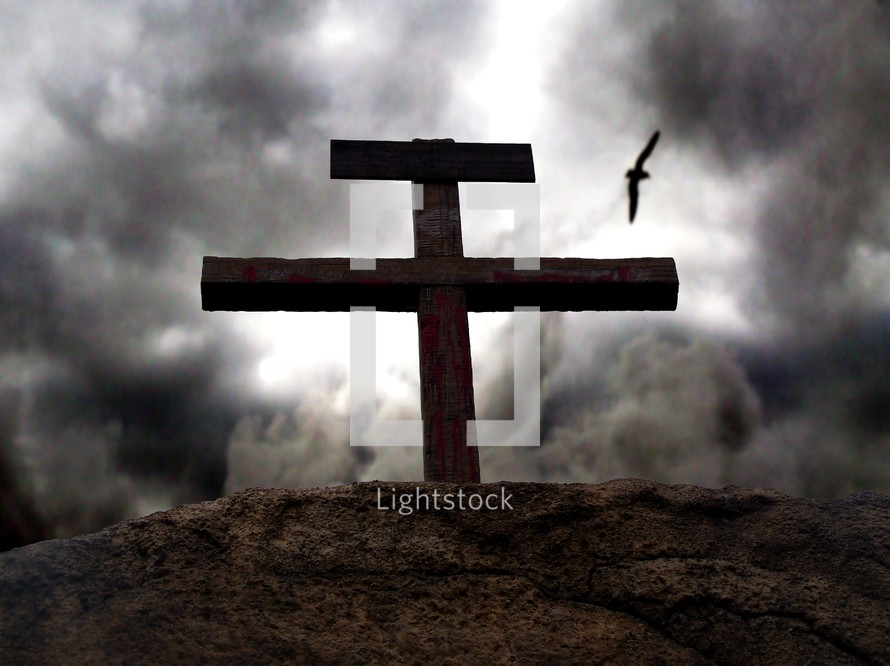 Dark skies gather around the rugged, bloodied cross on Gogatha where Jesus died on the cross for the sins of mankind.