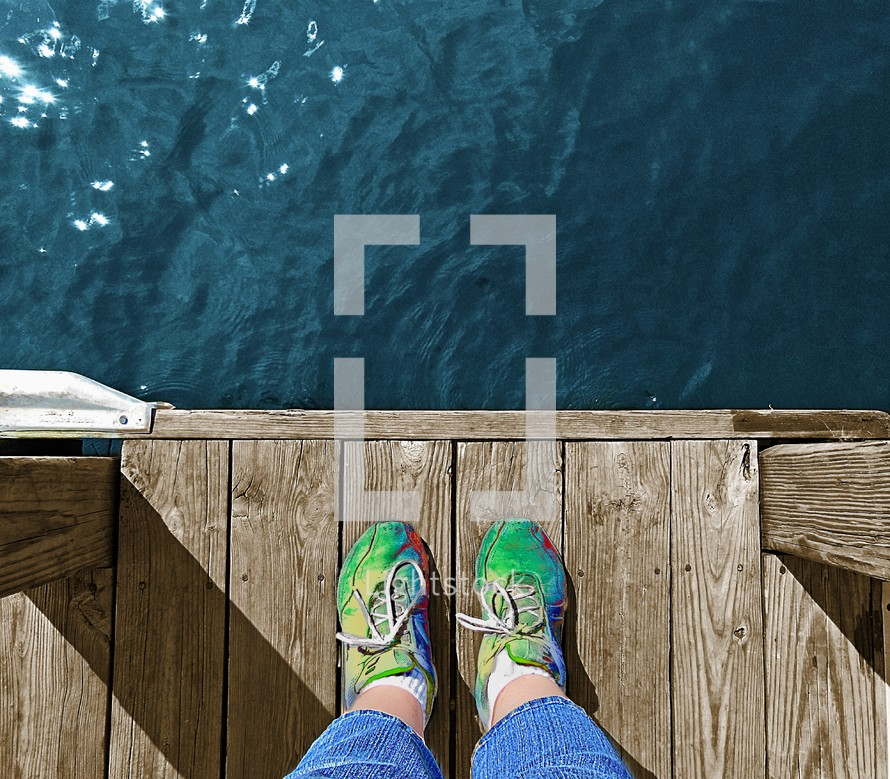 Feet at the end of a dock.