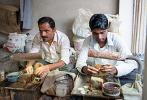 men making clothes in India