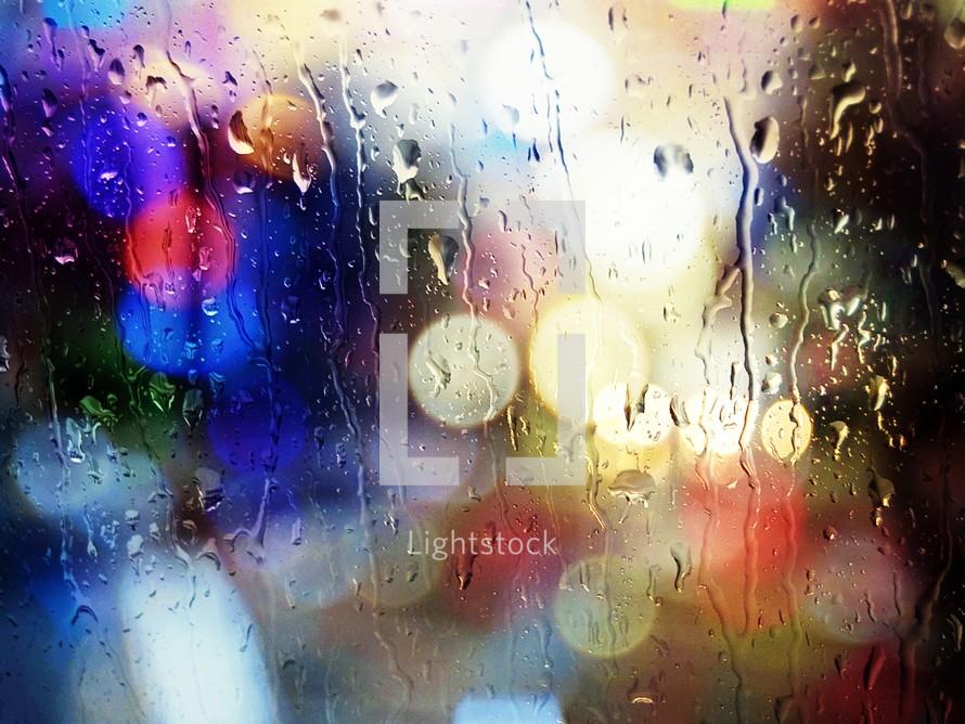 Bokeh image of raindrops on a window pane.