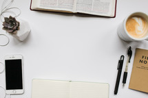 a desk with a border of items for a Bible study