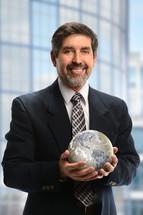 Businessman holding a globe