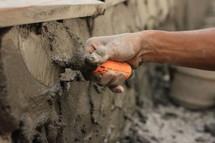 a man troweling concrete